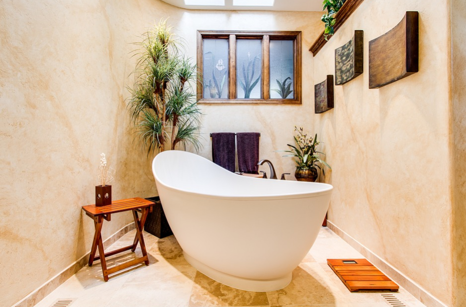 Bathtub in a bathroom with plants