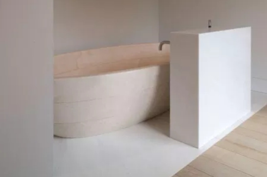 Minimal bathroom with peach bathtub