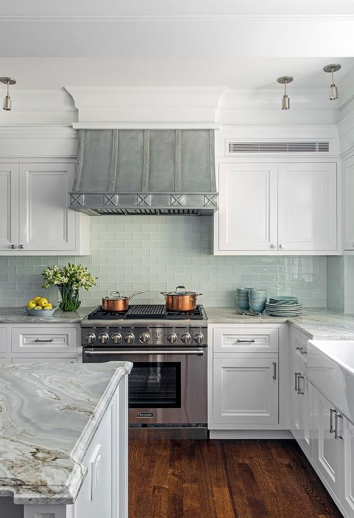 Aqua blue tiles in kitchen with French hood