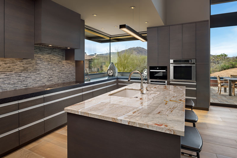 Modern kitchen design with dark cabinets