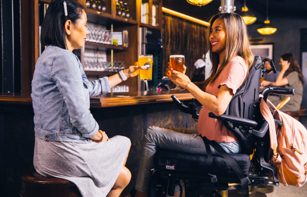 Two women drinking together